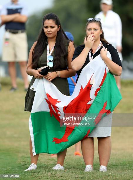 Welsh supporters following Jack Davidson and David Boote of the Great Britain and Ireland team during the morning foursomes matches in the 2017...