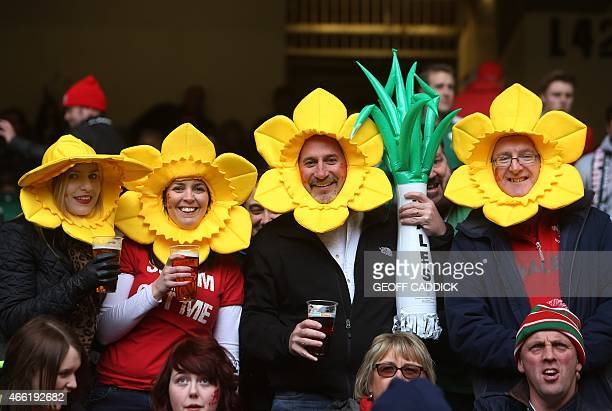 Welsh supporters in fancy dress await the start of the Six Nations international rugby union match between Wales and Ireland at The Millennium...