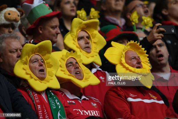 Welsh supporters singing in the crowd before the Six Nations international rugby union match between Wales and Ireland at the Principality Stadium in...