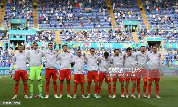 Welsh team sing their national anthem during the UEFA Euro 2020 Championship Group A match between Italy and Wales at Olimpico Stadium on June 20,...