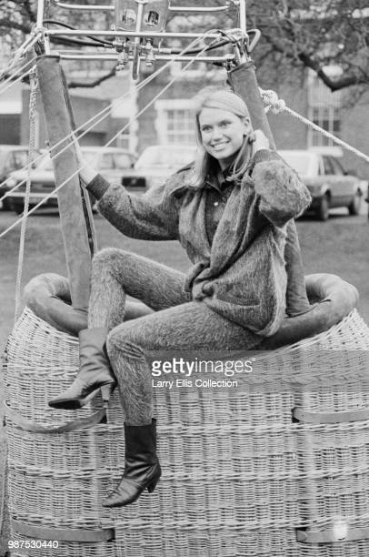 Welsh television presenter Anneka Rice who hosts the television game show 'Treasure Hunt' pictured seated on a hot air balloon wicker basket circa...