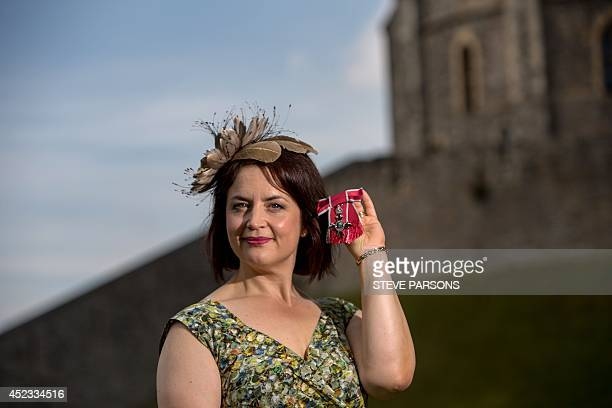 Welsh TV actress Ruth Jones poses with her MBE for services to Entertainment presented to her by Queen Elizabeth II at a Investiture ceremony at...