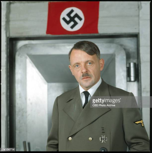 Welshborn American actor Sir Anthony Hopkins in costume as Adolf Hitler in scene from the madefortelevision movie 'The Bunker' directed by George...