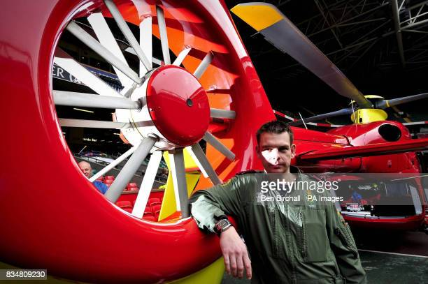 Welshpool air ambulance paramedic Chris Edwards stands next to the tail rota of a Eurocopter EC135 that Wales Air Ambulance pilot Pete Cummins...