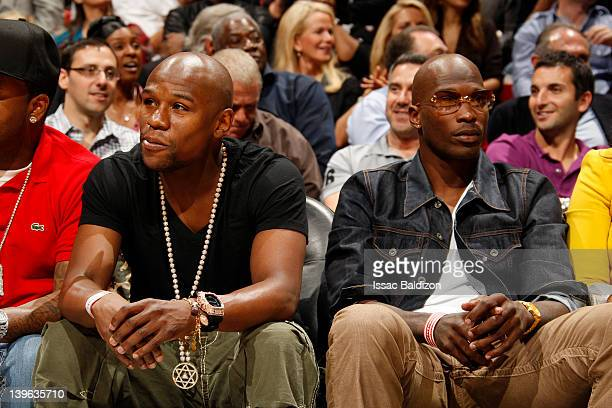 WBC welterweight boxing champion Floyd Mayweather Jr and New England Patriots wide receiver Chad Javon Ochocinco watch the game between the New York...