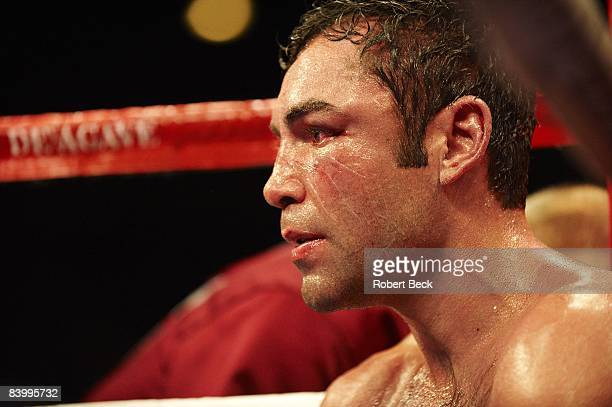 Closeup of Oscar De La Hoya sitting in corner between rounds of fight vs Manny Pacquiao at MGM Grand Face covered with vaseline Las Vegas NV...