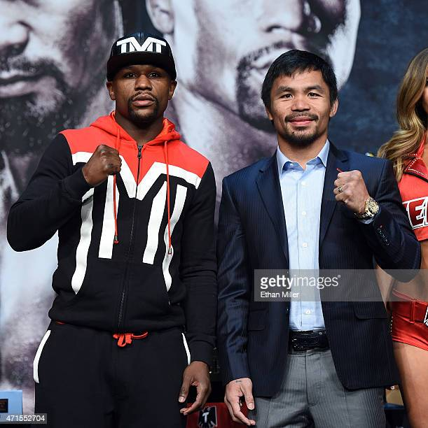 Welterweight champion Floyd Mayweather Jr. And WBO welterweight champion Manny Pacquiao pose during a news conference at the KA Theatre at MGM Grand...