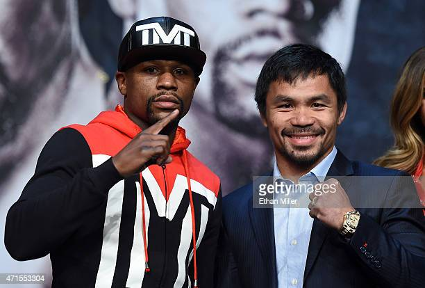 WBA welterweight champion Floyd Mayweather Jr and WBO welterweight champion Manny Pacquiao pose during a news conference at the KA Theatre at MGM...