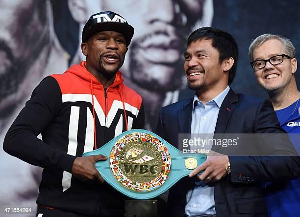 WBC/WBA welterweight champion Floyd Mayweather Jr and WBO welterweight champion Manny Pacquiao pose with a WBC championship belt as Pacquiao's...