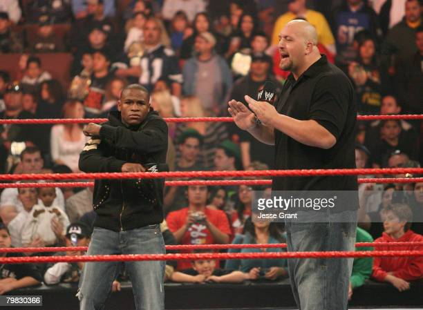 Welterweight Champion Floyd Mayweather Jr. And WWE Superstar Big Show confront one another at WWE Monday Night Raw at The Honda Center on February...