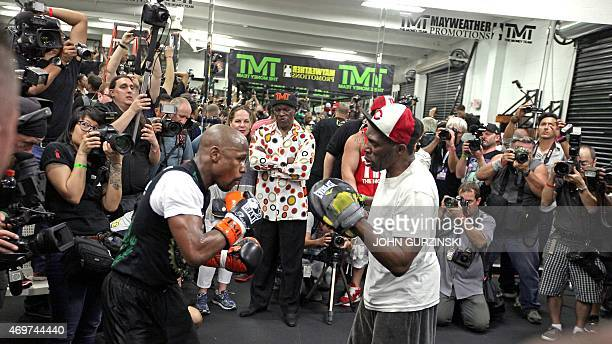 WBC/WBA welterweight champion Floyd Mayweather Jr works out with his uncle Roger Mayweather at the Mayweather Boxing Club on April 14 2015 in Las...