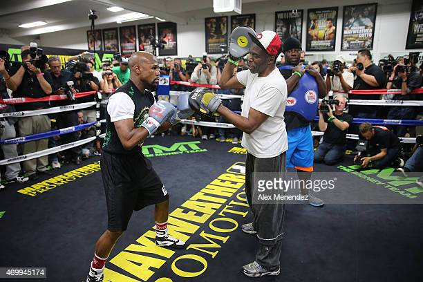 WBA welterweight champion Floyd Mayweather Jr works out with his uncle Roger Mayweather at the Mayweather Boxing Club on April 14 2015 in Las Vegas...