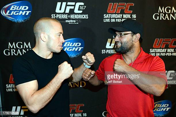 UFC welterweight champion Georges StPierre and Johny Hendricks square off for the media during the UFC World Tour 2013 in the lobby of the MGM Grand...