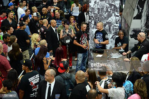 Welterweight champion Georges St-Pierre greets fans during the UFC Fan Expo Las Vegas 2013 at the Mandalay Bay Convention Center on July 6, 2013 in...
