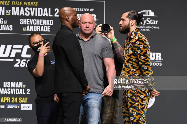Welterweight Champion Kamaru Usman of Nigeria and Jorge Masvidal face off during the UFC 261 press conference at VyStar Veterans Memorial Arena on...