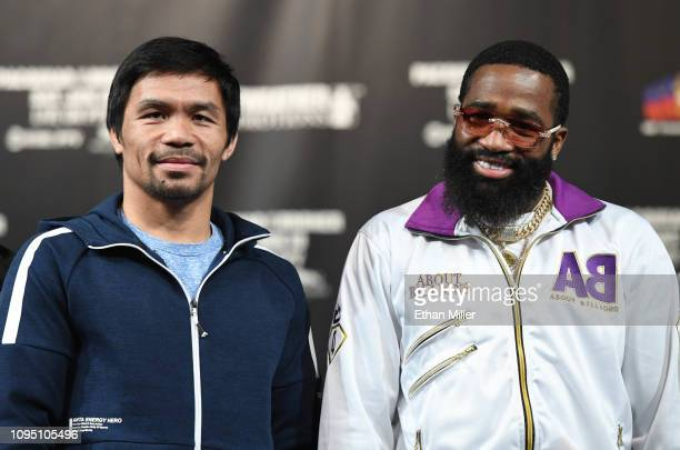 Welterweight champion Manny Pacquiao and Adrien Broner pose during a news conference at MGM Grand Hotel & Casino on January 16, 2019 in Las Vegas,...