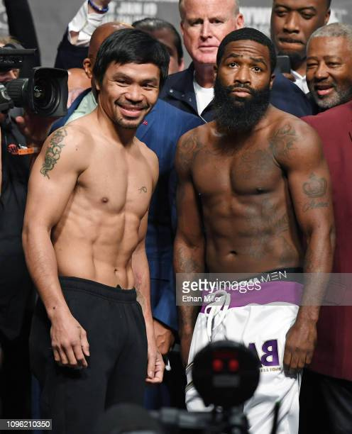 Welterweight champion Manny Pacquiao and Adrien Broner pose during their official weigh-in at MGM Grand Garden Arena on January 18, 2019 in Las...