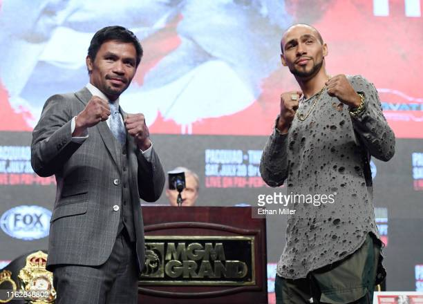 WBA welterweight champion Manny Pacquiao and WBA welterweight super champion Keith Thurman pose during a news conference at MGM Grand Garden Arena on...