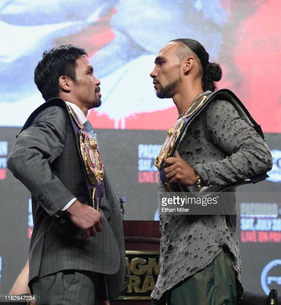 WBA welterweight champion Manny Pacquiao and WBA welterweight super champion Keith Thurman face off during a news conference at MGM Grand Garden...