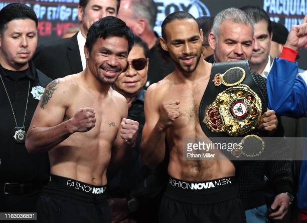 WBA welterweight champion Manny Pacquiao and WBA welterweight super champion Keith Thurman pose during their official weighin at MGM Grand Garden...
