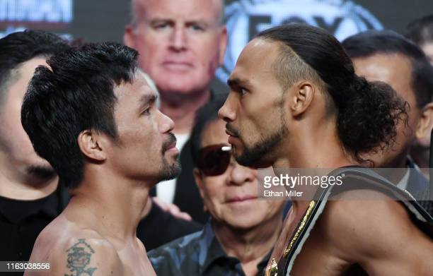 Welterweight champion Manny Pacquiao and WBA welterweight super champion Keith Thurman face off during their official weigh-in at MGM Grand Garden...