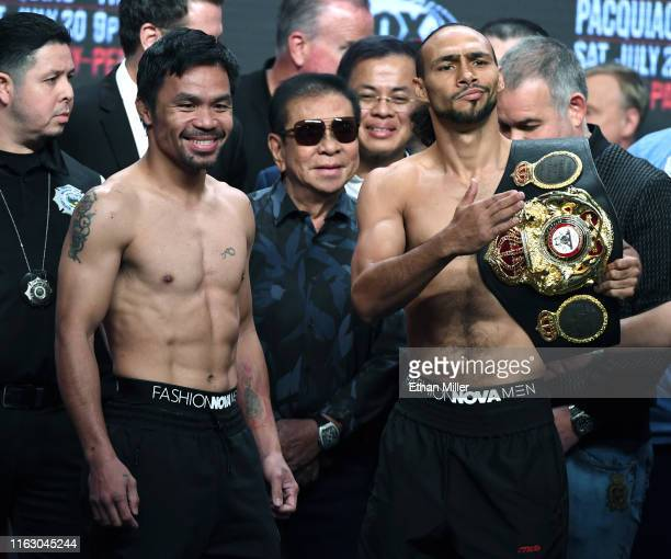 WBA welterweight champion Manny Pacquiao and WBA welterweight super champion Keith Thurman pose during their official weighin as former Gov of the...