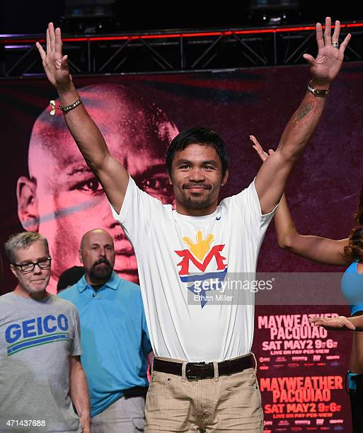 Welterweight champion Manny Pacquiao arrives at a fan rally at the Mandalay Bay Convention Center with his trainer Freddie Roach on April 28, 2015 in...