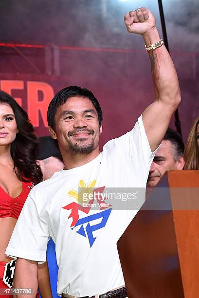 Welterweight champion Manny Pacquiao gestures during a fan rally at the Mandalay Bay Convention Center on April 28, 2015 in Las Vegas, Nevada....