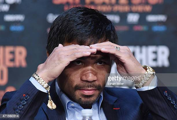 WBO welterweight champion Manny Pacquiao looks out at members of the media during a news conference at the KA Theatre at MGM Grand Hotel Casino on...