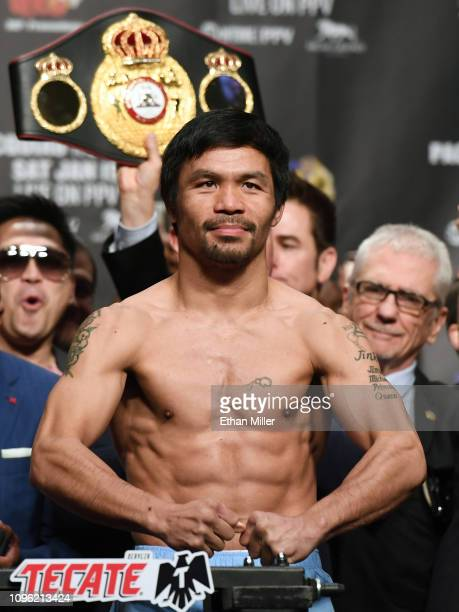 WBA welterweight champion Manny Pacquiao poses on the scale during his official weighin at MGM Grand Garden Arena on January 18 2019 in Las Vegas...