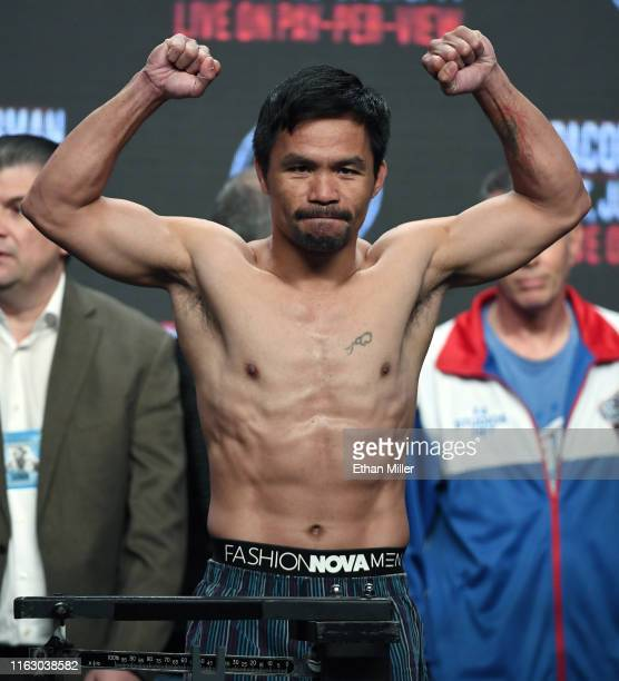 WBA welterweight champion Manny Pacquiao poses on the scale during his official weighin at MGM Grand Garden Arena on July 19 2019 in Las Vegas Nevada...