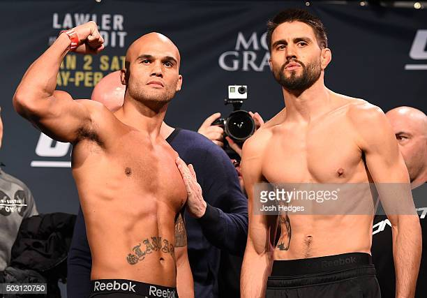 UFC welterweight champion Robbie Lawler and opponent Carlos Condit pose for photos during the UFC 195 weighin at the MGM Grand Conference Center on...