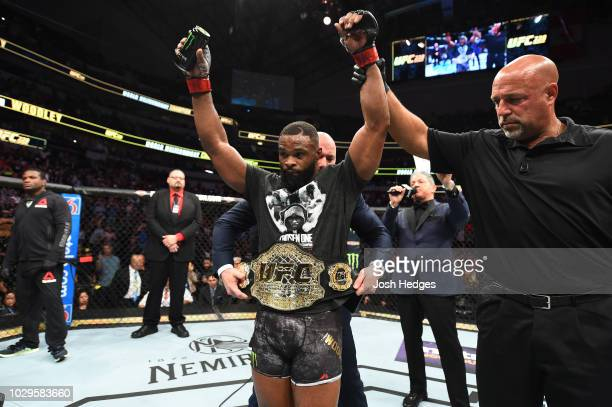 UFC welterweight champion Tyron Woodley celebrates after defeating Darren Till of England in their UFC welterweight championship fight during the UFC...