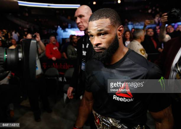 UFC welterweight champion Tyron Woodley leaves the Octagon after his title defense against Stephen Thompson at UFC 209 on March 4 2017 in Las Vegas...