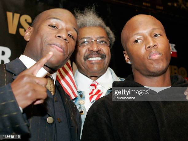 IBF Welterweight Champion Zab Judah and Floyd Mayweather pose with promoter Don King at the press conference announcing their upcoming fight The...