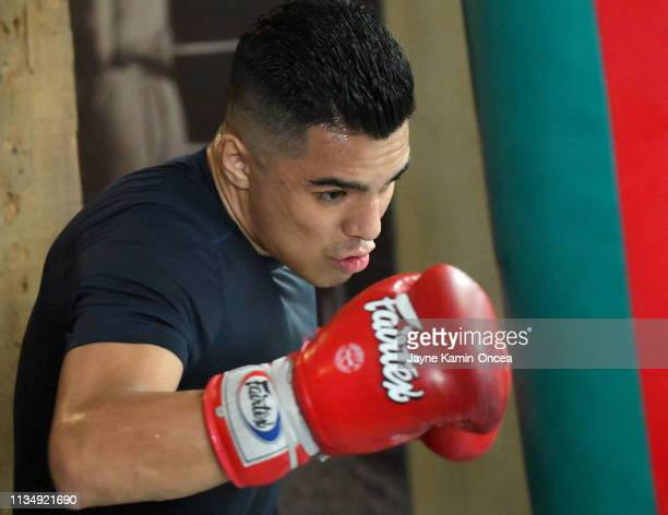 Welterweight Contender Adrian Granados hits a heavybag during a media day workout for his upcoming fight against Danny Swift Garcia at Fortune Gym on...