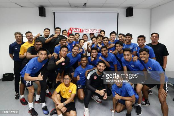 UFC welterweight contender and former lightweight champion Rafael dos Anjos poses for a photo with the Garena Young Lions football team during the...