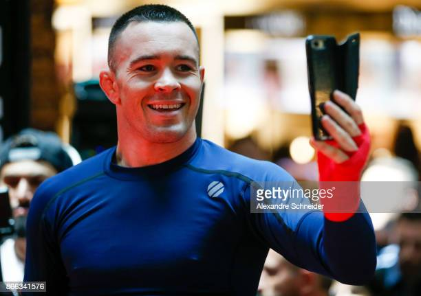 Welterweight contender Colby Covington takes a photo during the Open Workouts at the Vila Olimpia Mall for the UFC Fight Night Sao Paulo on October...