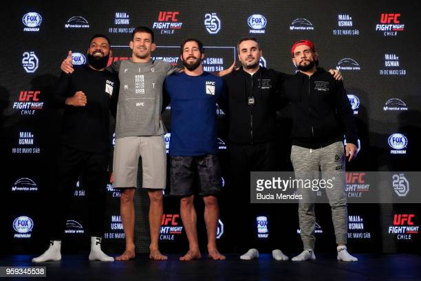 UFC welterweight contender Demian Maia of Brazil poses with his teammates during an open training session at Mall Sport on May 16 2018 in Santiago...