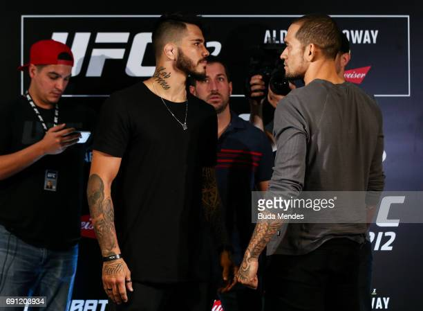 UFC welterweight fighters Erick Silva of Brazil and Yancy Medeiros of the United States face off during Ultimate Media Day at Windsor Hotel on June...