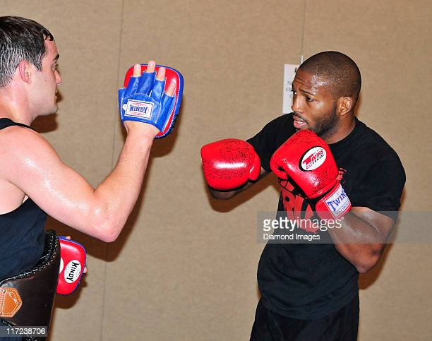 Welterweight John Howard works out with a sparring partner during an open workout at the Hyatt Regency on June 24, 2011 in Pittsburgh, Pennsylvania.