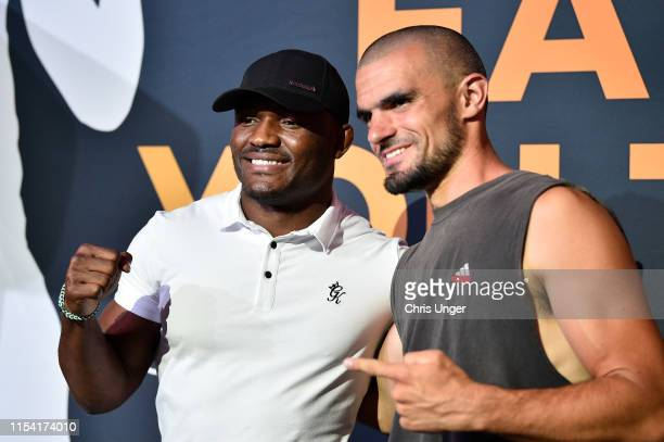 UFC welterweight Kamaru Usman poses for a photo with a fan during the UFC Fan Experience at the Downtown Las Vegas Events Center on July 6 2019 in...