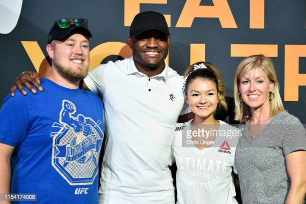 UFC welterweight Kamaru Usman poses for a photo with fans during the UFC Fan Experience at the Downtown Las Vegas Events Center on July 6 2019 in Las...