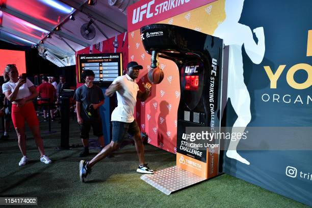 UFC welterweight Kamaru Usman punches the bag during the UFC Fan Experience at the Downtown Las Vegas Events Center on July 6 2019 in Las Vegas Nevada