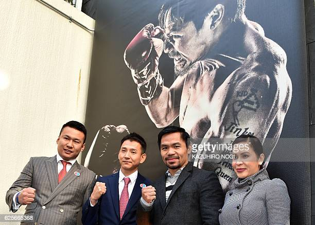 WBO welterweight world champion Manny Pacquiao and his wife Jinkee pose for the media while MP Promotion Japan president Yoshihiro Agata looks on...