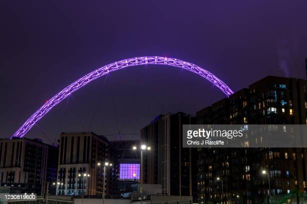Wembley Stadium is lit in purple light to mark Holocaust Memorial Day on January 27, 2021 in London, United Kingdom. Holocaust Memorial Day is an...