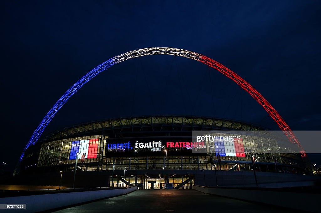Wembley stadium is lit up in the French Tricolore in remembrance to the victims of last weeks terror attacks in Paris prior to the France training session at Wembley Stadium on November 16, 2015 in London, England.