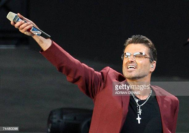 George Michael performs during his 25Live concert at the Wembley Stadium in London 09 June 2007 The concert is the first in the new arena AFP PHOTO...