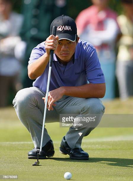 Wen Chong Liang of China lines up his putt on the nineth hole during the third round of the Omega Mission Hills World Cup at the Mission Hills Golf...