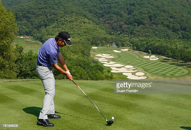Wen Chong Liang of China plays a tee shot during the third round of the Omega Mission Hills World Cup at the Mission Hills Golf Resort on November 24...